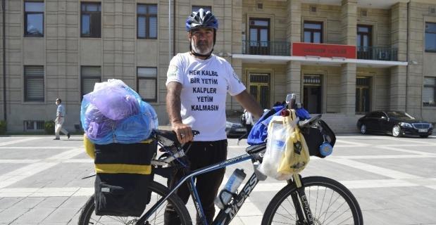 Yetimler için bisikletiyle bin kilometre yol